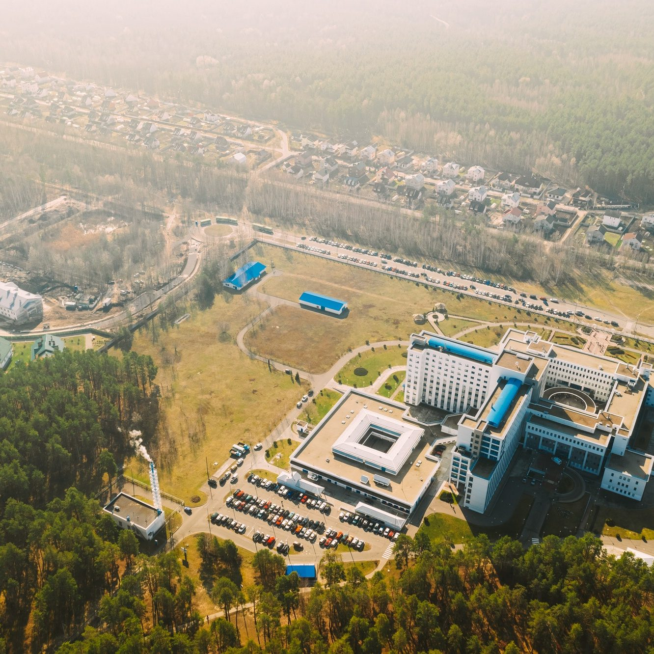 Aerial View OF Building Of Hospital In Spring Sunny Day. Top View. Drone View. Bird's Eye View